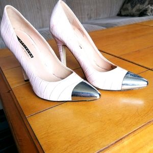 Pink shoes with chrome toe